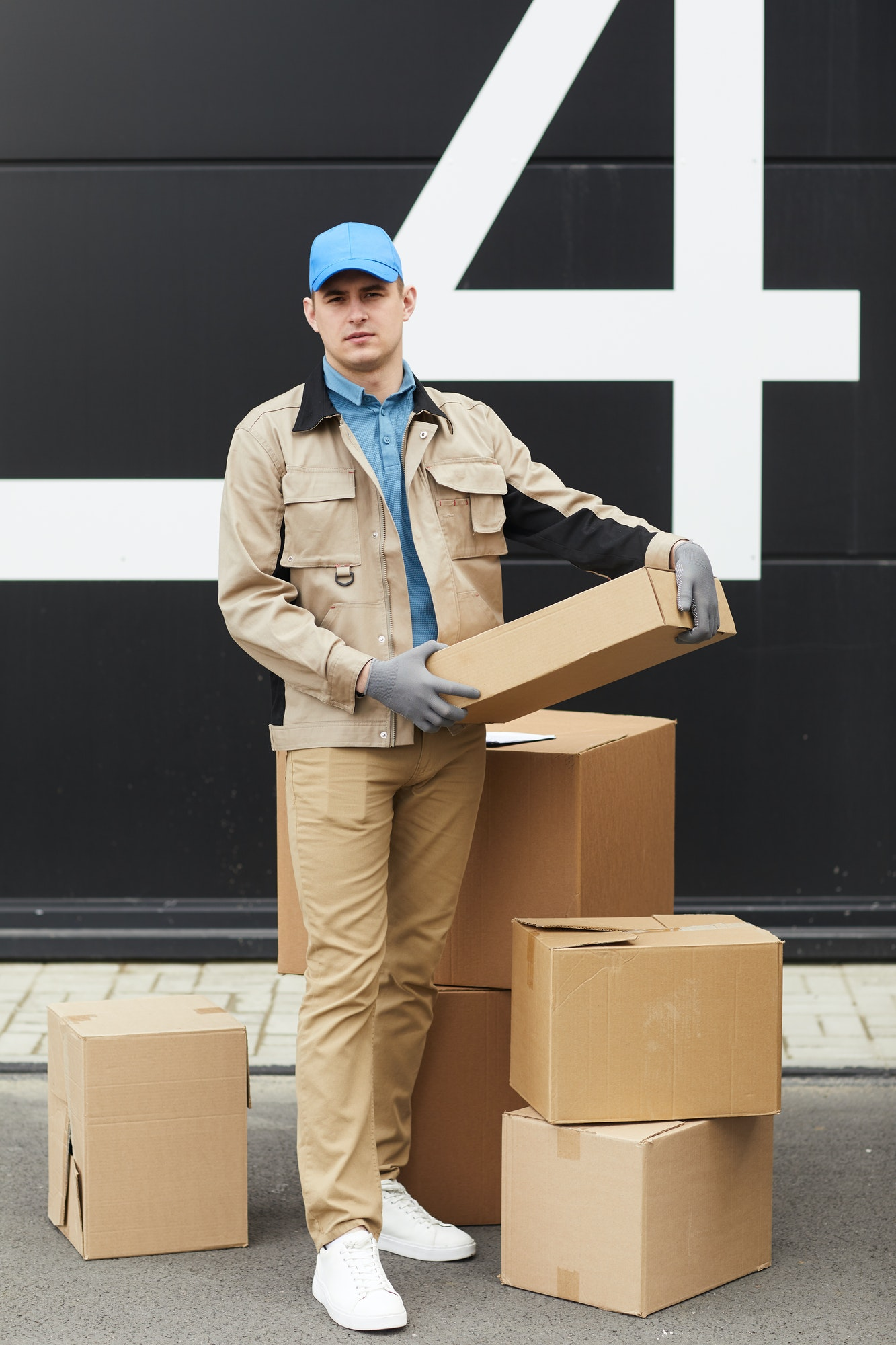 courier-working-with-parcels-in-warehouse.jpg