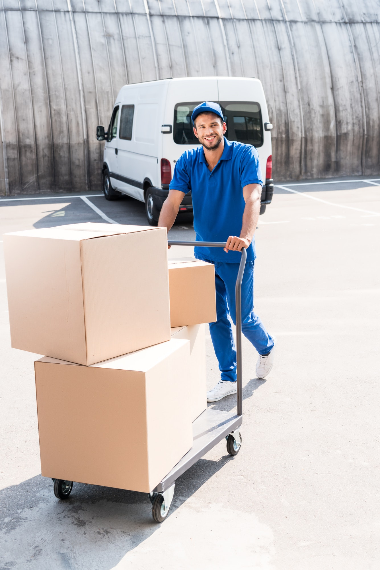 happy-delivery-man-with-cardboard-boxes-on-cart.jpg